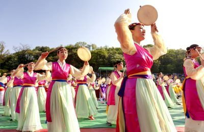 Actresses are performing at Buddhist Cheer Rally for celebration of Lotus Lantern Festival at Dongguk University Stadium, Seoul, Korea.